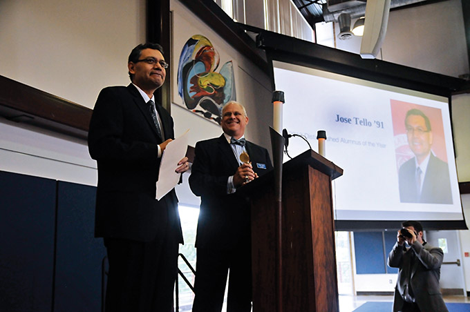 President Michael Earsing, at right, introduces José Tello, winner of the Distinguished Alumnus of the Year Award, during a special assembly at Jesuit College Preparatory School Oct. 18. (Jenna Teter/Texas Catholic)