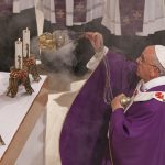 Pope Francis uses incense as he celebrates Mass at the Parish of San Cirillo Alessandrino in Rome Dec. 1. (CNS photo/Paul Haring)