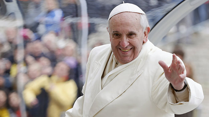 Pope Francis waves as he leaves his general audience in St. Peter's Square at the Vatican Jan. 29. (CNS photo/Tony Gentile, Reuters) (Jan. 29, 2014)