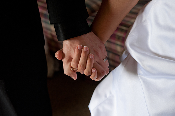 A groom and bride hold hands on their wedding day.  (CNS file photo/Jon L. Hendricks)