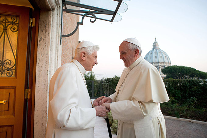 Retired Pope Benedict XVI greets Pope Francis at the Mater Ecclesiae monastery at the Vatican Dec. 23. The monastery, located in the Vatican Gardens to the north of St. Peter's Basilica, is where Pope Benedict is living. (CNS photo/L'Osservatore Romano via Reuters)