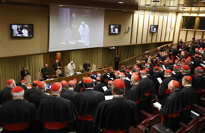 Pope Francis leads opening prayer during a meeting of cardinals in the synod hall at the Vatican Feb. 20. The pope asked the world's cardinals and those about to be made cardinals to meet at the Vatican Feb. 20-21 to discuss the church's pastoral approach to the family. (CNS photo/Paul Haring)