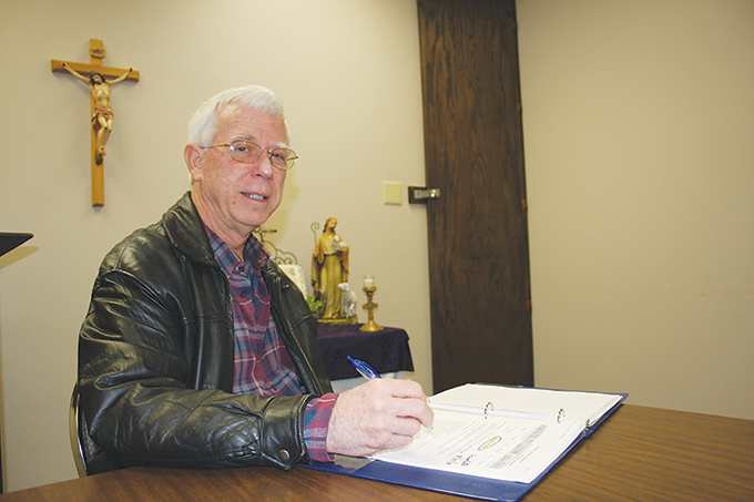 """Richard """"Joe"""" Walshe, a parishioner at Good Shepherd Catholic Church in Garland, earned his second catechetical certificate through the University of Dayton Virtual Learning Community of Faith Formation in 2013. (CATHY HARASTA/The Texas Catholic)"""