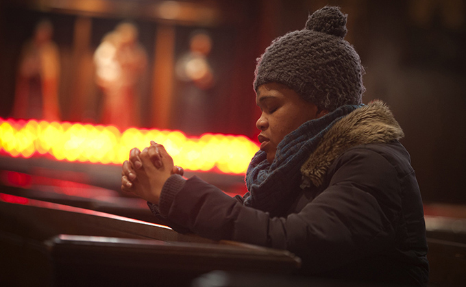 A woman prays during Ash Wednesday Mass at St. Andrew's Church in the Manhattan borough of New York March 5. Ash Wednesday marks the start of the penitential season of Lent, a time of reflection, prayer, fasting and charity before Easter. (CNS photo/Carlo Allegri, Reuters)