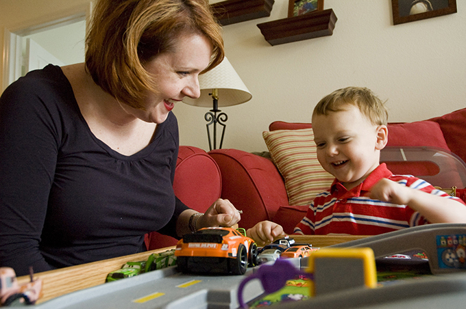 Bridget Golden and her 2-year-old son, Andrew, play with cars at their home last year in Hendersonville, Tenn.  (CNS photo/Theresa Laurence, Tennessee Register)