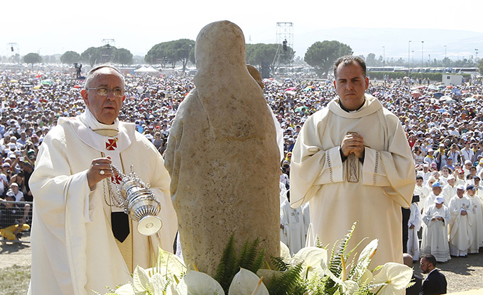 """Pope Francis uses incense as he celebrates a Mass attended by 250,000 people in Sibari, in Italy's Calabria region, June 21. During his homily, the pope said """"mafiosi"""" are not in communion with God and are excommunicated. The Calabria region is home of the 'Ndrangheta crime organization, known for drug trafficking. (CNS photo/Paul Haring)"""