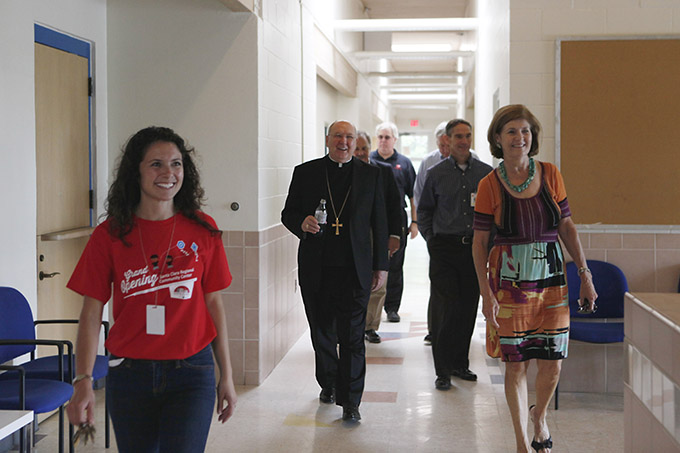 Bishop Kevin J. Farrell tours the Santa Clara Regional Community Center during the grand opening of the center on  June 14 at Santa Clara Catholic Church in Dallas. (BEN TORRES/Special Contributor)