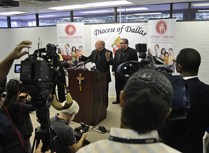 Bishop Kevin J. Farrel gestures during a press conference to discuss the humanitarian crisis of unaccompanied minors into the U.S at the Dallas Pastoral Center in Dallas July 21. (JENNA TETER/The Texas Catholic)