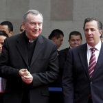 Mexican Foreign Minister Jose Antonio Meade Kuribrena walks with Cardinal Pietro Parolin, Vatican secretary of state,   in Mexico City July 13. Cardinal Parolin traveled to Mexico to discuss the flow of child migrants from Central America with regional counterparts. (CNS photo/courtesy of SRE)