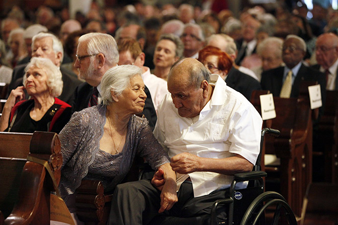 Married couple Guadalupe Contreras smiles at her husband Santos Contreras while whispering to him during a special mass by Bishop Kevin Farrell honoring married couples, on Saturday, Sept. 07, 2014 at the Cathedral Shrine of the Virgin of Guadalupe in Downtown Dallas. The couples has been married for 54 years. (Ben Torres/Special Contributor)