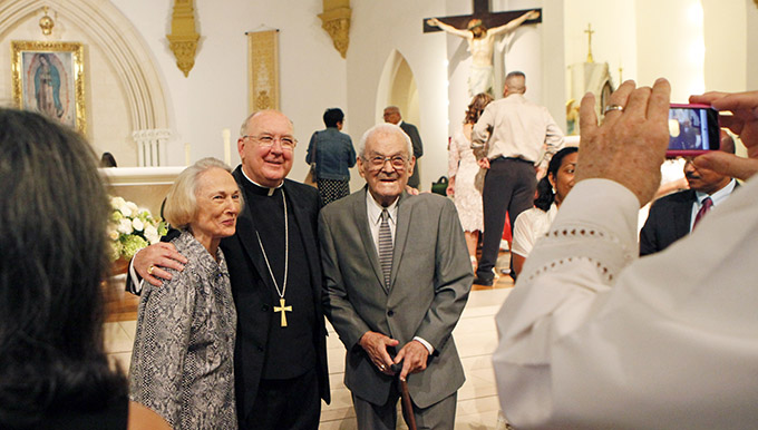 Bishop Kevin J. Farrell poses with Nancy and Robert Fisette, who have been married for 64 years, after a the inaugural Silver & Gold Mass, honoring married couples on Sept. 7 at the Cathedral Shrine of the Virgin of Guadalupe in downtown Dallas. (Ben Torres/Special Contributor)
