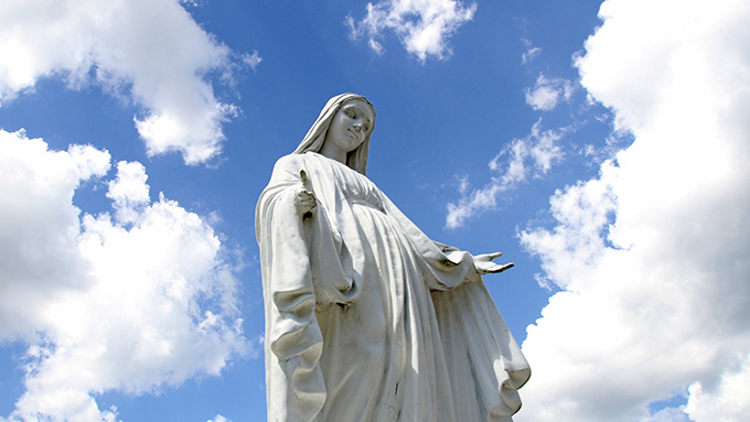 A statue of Mary overlooks the grounds of St. Jude Church in Mastic Beach, N.Y. (CNS Photo)