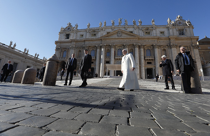 Pope Francis leaves his general audience in St. Peter's Square at the Vatican Dec. 10. (CNS photo/Paul Haring)