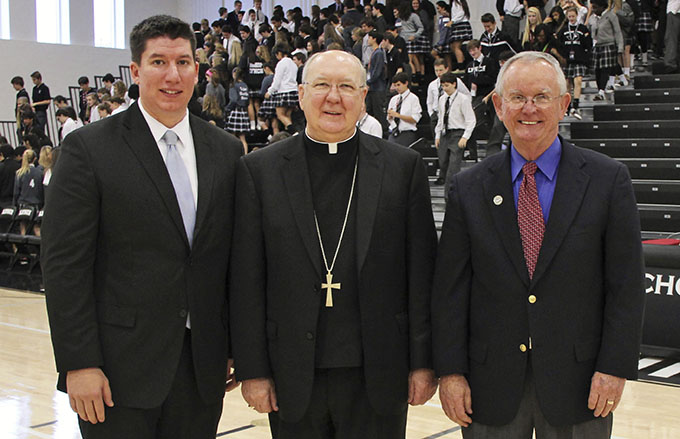 Chris Rebuck (left), Bishop Kevin J. Farrell and Ed Leyden pose for a photo after an all-school morning assembly at Bishop Lynch High School on Dec. 5. Rebuck was announced as the school's next president. (JENNA TETER/The Texas Catholic)