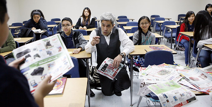 Catechist Jonathan Hoang, center, lectures during a seventh-grade faith formation class at St. Joseph Vietnamese Catholic Church in Grand Prairie on Dec. 7. (BEN TORRES/Special Contributor)