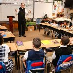 Father Jason Cargo talks to third-grade students in Thelma Lockwood's classroom at James L. Collins Catholic School in Corsicana. (DON JOHNSON/Special Contributor)