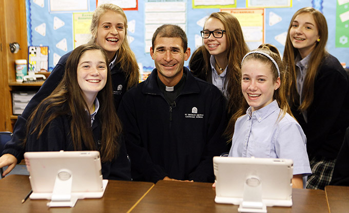 Father James Yamauchi visits with eighth-graders at St. Thomas Aquinas Catholic School, on Dec. 10. (BEN TORRES/Special Contributor)
