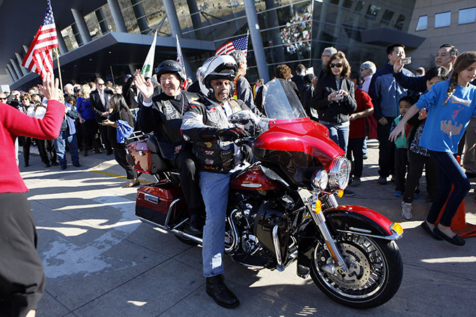 Bishop Kevin J. Farrell, left, waves from a Harley Davidson motorcycle at the start of the North Texas March for Life on Jan. 17. (BEN TORRES/Special Contributor)