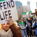 Pro-life supporters march through downtown Dallas during the North Texas March for Life Jan. 17.  (BEN TORRES/Special Contributor)