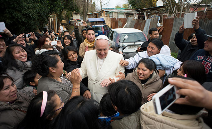 Latin American immigrants in Rome greet Pope Francis Feb. 8. (CNS photo/L'Osservatore Romano via EPA)