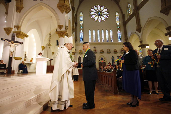 Bishop Kevin J. Farrell presents a Bishop's Award for Service to the Church to George Saldivar of Immaculate Conception Catholic Church in Grand Prairie, during a special Mass at the Cathedral Shrine of the Virgin of Guadalupe in downtown Dallas. (BEN TORRES/Special Contributor)