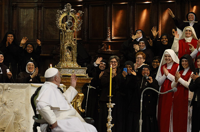 Pope Francis waves during a meeting with religious at the cathedral in Naples, Italy, March 21. (CNS photo/Paul Haring)