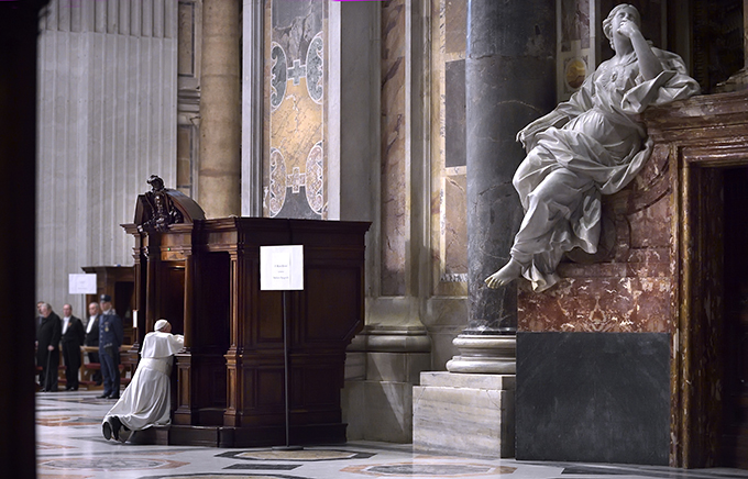 Pope Francis goes to confession during a Lenten penance service in St. Peter's Basilica at the Vatican March 13. (CNS photo/Stefano Spaziani)