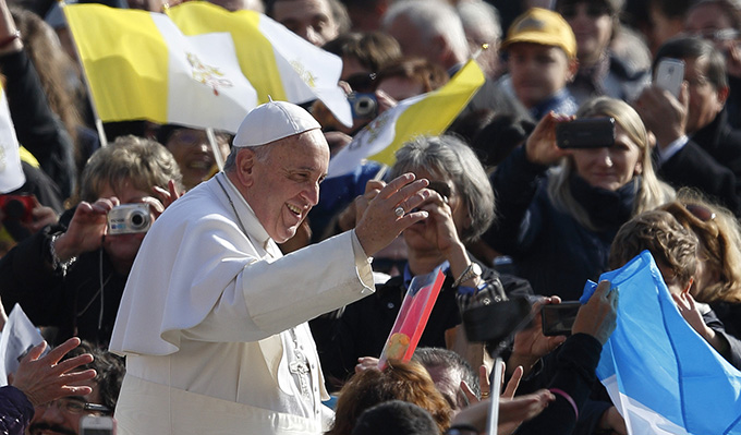 Pope Francis greets the crowd as he arrives to lead his general audience in St. Peter's Square at the Vatican March 4. (CNS photo/Paul Haring)
