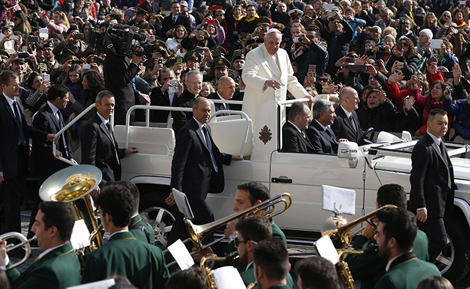 Pope Francis passes a band as he arrives to lead his general audience in St. Peter's Square at the Vatican March 11. (CNS photo/Paul Haring)