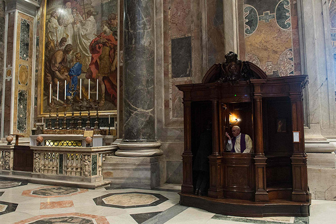 Pope Francis hears confession during a penitential liturgy in St. Peter's Basilica at the Vatican March 28. Pope Francis surprised his liturgical adviser by going to confession during the service. (CNS photo/L'Osservatore Romano via Reuters)
