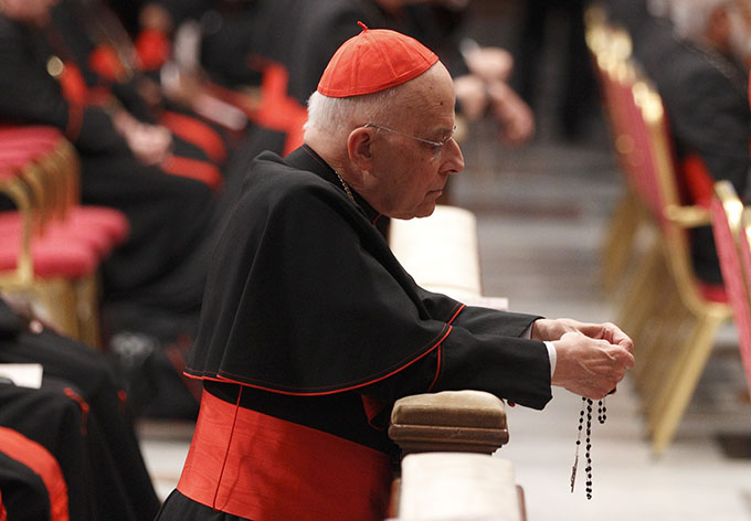 Cardinal Francis E. George of Chicago prays the rosary before a prayer service with eucharistic adoration in St. Peter's Basilica at the Vatican in 2013.  Cardinal George, 78, died April 17 after a long battle with cancer. (CNS photo/Paul Haring)