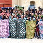 Seventh- and eighth-graders at Mary Immaculate Catholic School in Farmers Branch display hand-crafted blankets they will deliver to ill and traumatized children.
