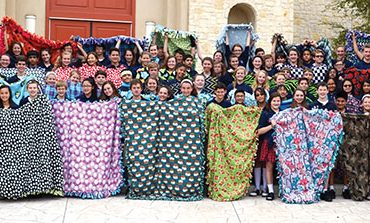 Students craft blankets for children in need