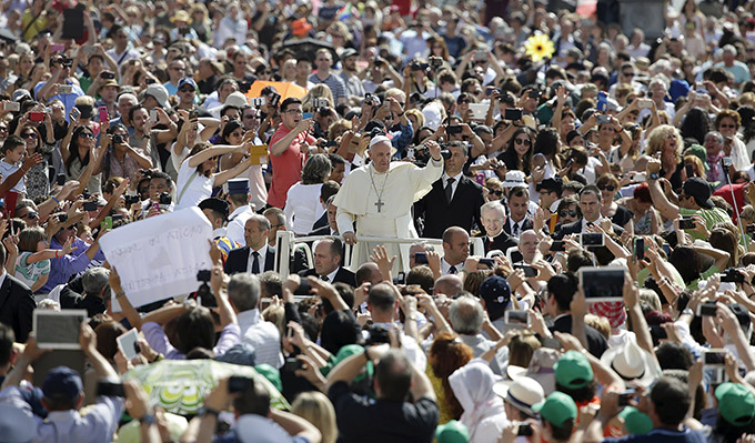 Pope Francis waves as he arrives to lead his general audience in St. Peter's Square at the Vatican June 17. (CNS photo/Max Rossi, Reuters)