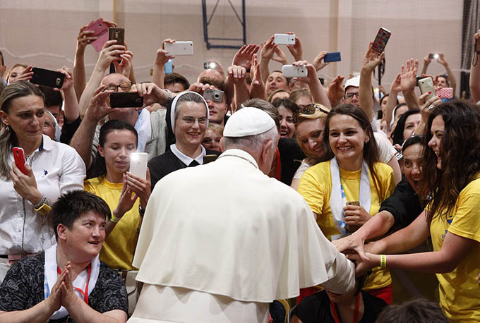 Pope Francis greets young people during a meeting with them at the diocesan John Paul II Youth Center in Sarajevo, Bosnia-Herzegovina, June 6. The pope made a one-day visit to Bosnia-Herzegovina to encourage a minority Catholic community in the faith and to foster dialogue and peace in a nation still largely divided along ethnic lines. (CNS photo/Paul Haring)