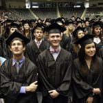 Charles Edward Anton, center, stands with his graduating class as they watch their classmates walk on to the arena floor during the 49th commencement for Bishop Lynch High School class of 2015, on Sunday, May 17, 2015 at the Curtis Culwell Center in Garland. Ben Torres/Special Contributor