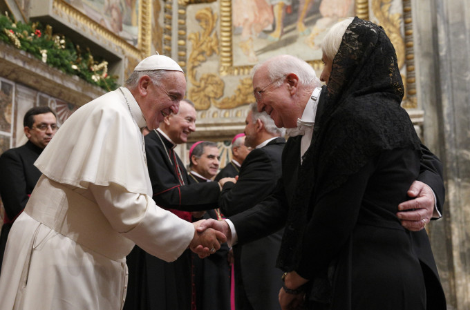 Pope Francis exchanges greetings with Ken Hackett, U.S. ambassador to the Holy See, and his wife, Joan, during a meeting with ambassadors to the Holy See at the Vatican Jan. 13. (CNS photo/Paul Haring)