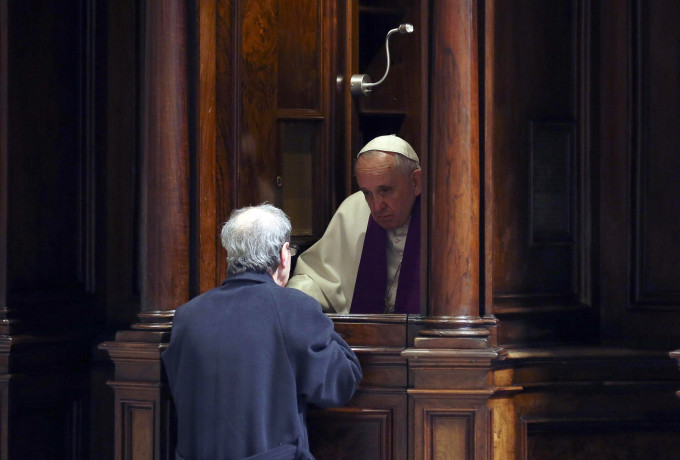 Pope Francis hears confession during a penitential liturgy in early March in St. Peter's Basilica at the Vatican. During his Aug. 2 Angelus, Pope Francis told people not to be afraid or ashamed to go to confession. (CNS photo/Alessandro Bianchi pool via EPA)