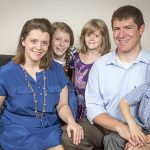Elisa and Steve Lowe pose with their children, from left, Robert, 9, Johanna, 11, John Paul, 4, and Claire, 7, at their home in Farmers Branch on July 29. (RON HEFLIN/Special Contributor)