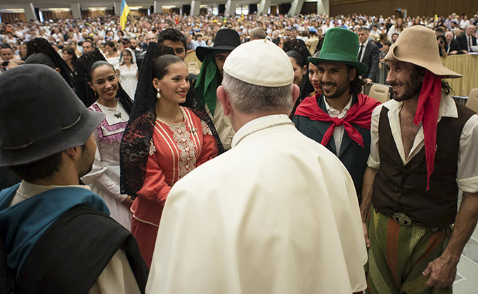 Pope Francis greets the pilgrims during his weekly audience in Paul VI hall at the Vatican Aug. 5. (CNS photo/L'Osservatore Romano via Reuters)