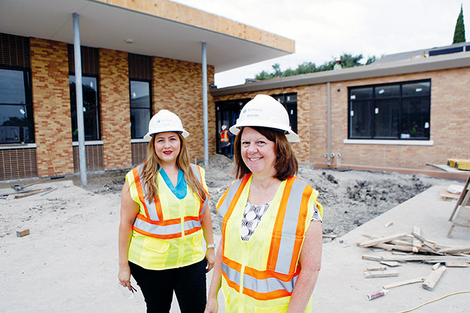 Principal Erica Romero, left, and President Marian Davis tour the ongoing construction of St. Philip & St. Augustine Catholic Academy in Pleasant Grove on Aug. 11. (BEN TORRES/Special Contributor)