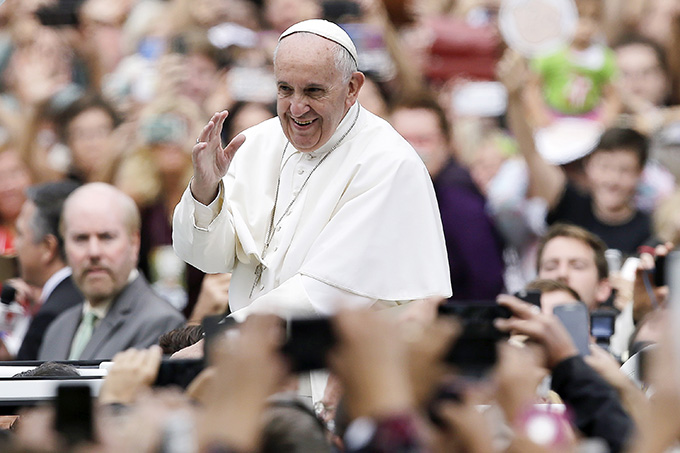 Pope Francis waves to the crowd as he makes his way to celebrate the closing Mass of the World Meeting of Families in Philadelphia Sept. 27.