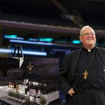 Cardinal Timothy M. Dolan of New York smiles as he waits to speak Sept. 2 about the chair Pope Francis will use when he celebrates Mass in Madison Square Garden. The Mass is set for Sept. 25. (CNS photo/Lucas Jackson, Reuters)
