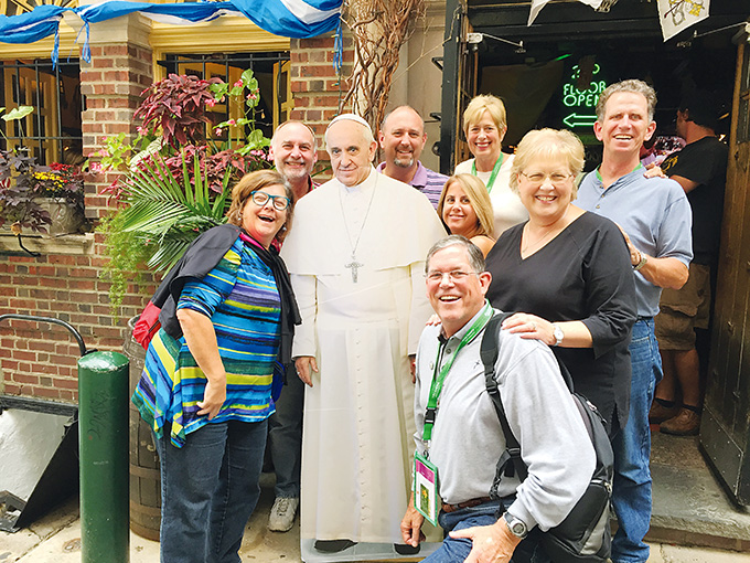 A group from St. Gabriel Catholic Church in McKinney poses with a life-size cutout of Pope Francis while visiting Philadelphia for the World Meeting of Families. (Photo by Deacon Mike Seibold)