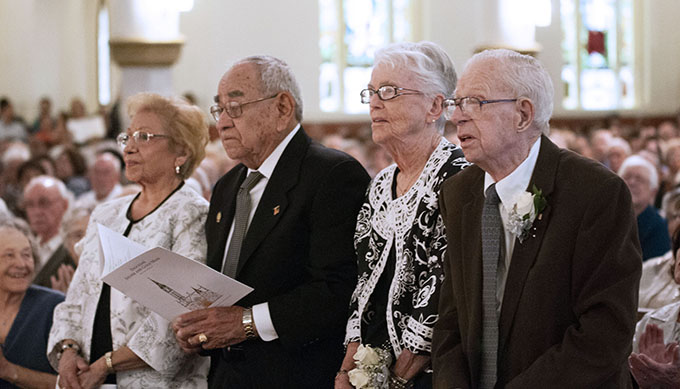 Beatrice and Albert Vera, from left, and Sally and Edward Pendergast stand and are recognized for their 70 years of marriage at the Diocesan Silver and Gold Mass. (JENNA TETER/The Texas Catholic)
