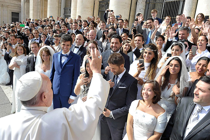 Pope Francis greets young married couples in St. Peter's Square, Sept. 30. The pope said everyone has a guardian angel who's advising and guiding throughout life. (CNS photo/L'Osservatore Romano)