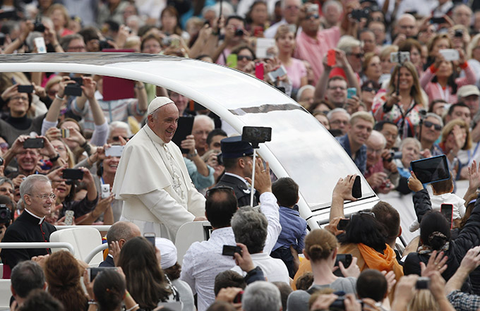 Pope Francis greets the crowd during his general audience in St. Peter's Square at the Vatican Oct. 14. (CNS photo/Paul Haring)