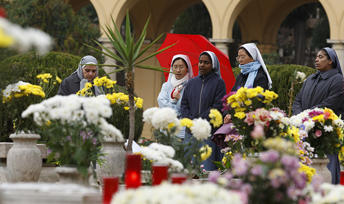 Nuns pray in the Verano cemetery in Rome on All Souls Day. The day commemorates the faithful who have died. (CNS photo/Paul Haring)
