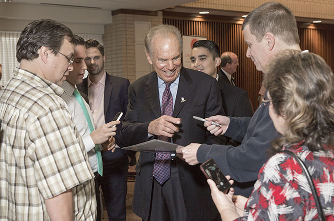Roger Staubach is surrounded by people seeking autographs at the Archangels Men's Network breakfast at St. Paul the Apostle Catholic Church in Richardson, Friday, Oct. 9, 2015 (Ron Heflin/Special Contributor)