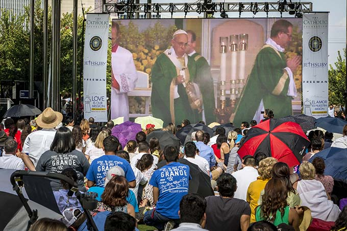 Pope Francis on the screen during the televised Mass celebrated by Pope Francis from Philadelphia and shown at Dallas' Klyde Warren Park Sunday, Sept. 27, 2015 (Ron Heflin/Special Contributor)